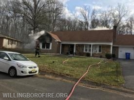Smoke still coming from the front of the home
